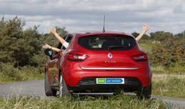 Image of red rental car with hands out of the windows